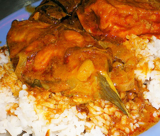 Pan-Fried Catfish curry over Rice